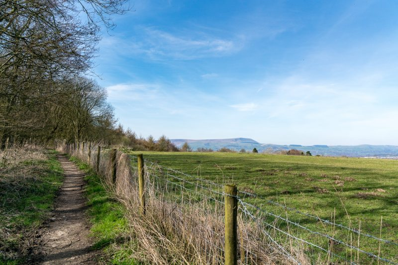 Photograph of Pendle Hill. Viewed from the footpath running alongside New Road (A646) in Burnley.