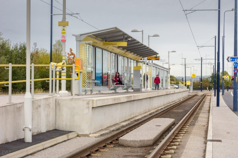 Photo of the Ashton Moss Tram Stop. The Metrolink stop opened in October 2013 and is located on Lord Sheldon Way in Ashton-under-Lyne.