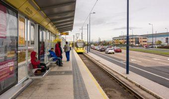 Photograph of a Metrolink tram approaching Ashton Moss Tram Stop in Ashton-under-Lyne, Greater Manchester.