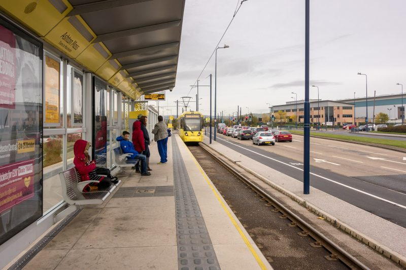 Photograph of a Metrolink tram approaching Ashton Moss Tram Stop in Ashton-under-Lyne, Greater Manchester.