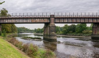 Photo of the East Lancashire Railway Viaduct and the River Ribble in Preston, Lancashire. Taken from Miller Park. The Old Tram Bridge can be seen in the distance.