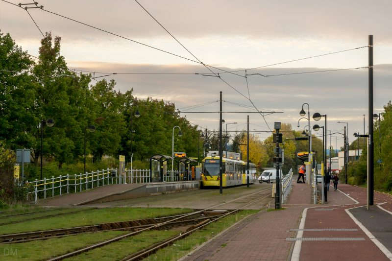 Photograph of a Metrolink tram at Broadway Tram Stop in Salford Quays, Greater Manchester.