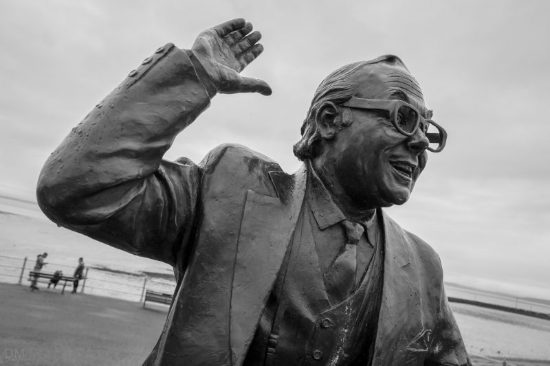 Photograph of Graham Ibbeson's Eric Morecambe statue on Morecambe Promenade.