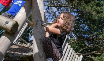 Photo of child on climbing frame at Natural Adventure Play Area, Happy Mount Park, Morecambe.