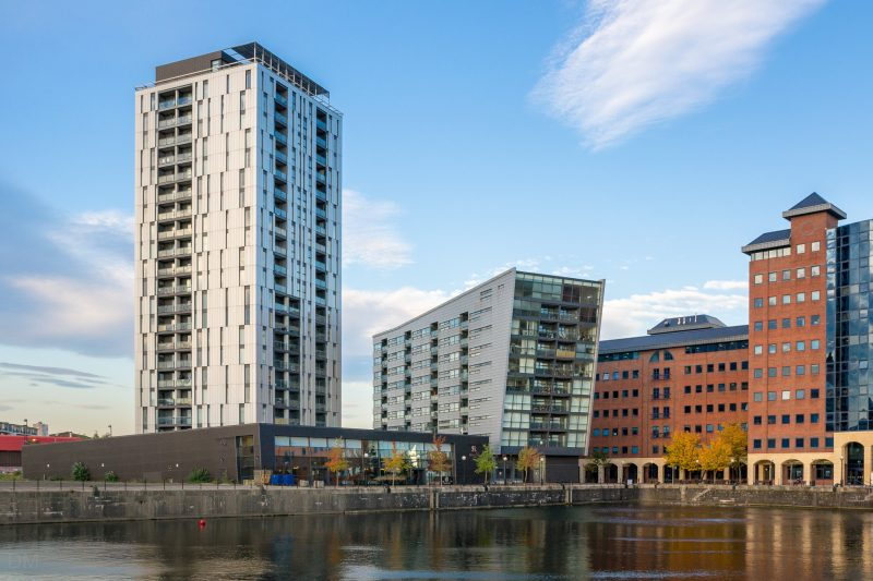 Photograph of buildings at Salford Quays. From left to right; Millennium Tower (apartments), Millennium Point (apartments), and The Anchorage (offices).