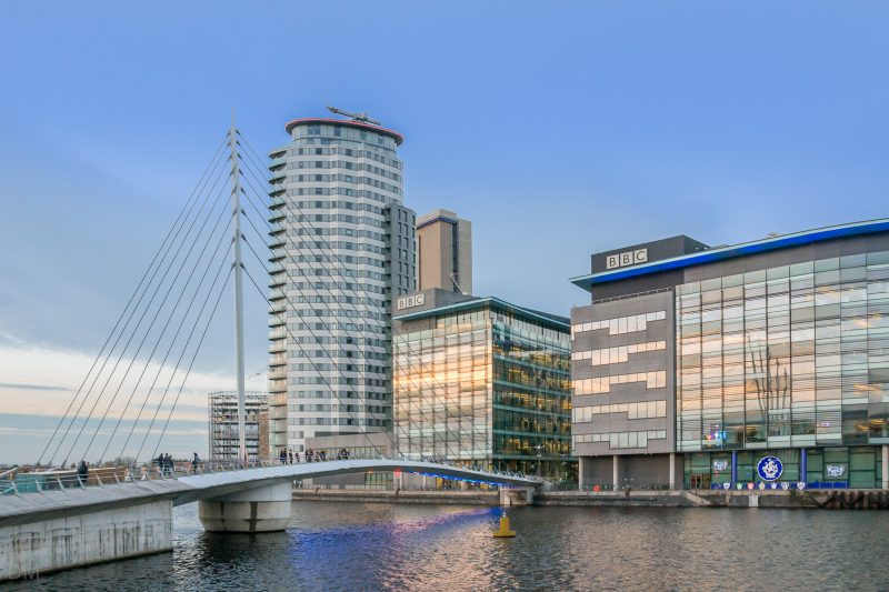 Photograph of MediaCityUK. Buildings from left to right are TheHeart (apartments), BBC Bridge House, and BBC Quay House.