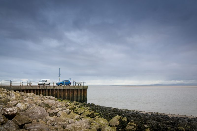 Photo of fishermen and their vehicles on the Stone Jetty, Morecambe Promenade.