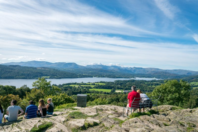 Photograph of people relaxing at Orrest Head, near Windermere. Windermere (lake) can be seen.