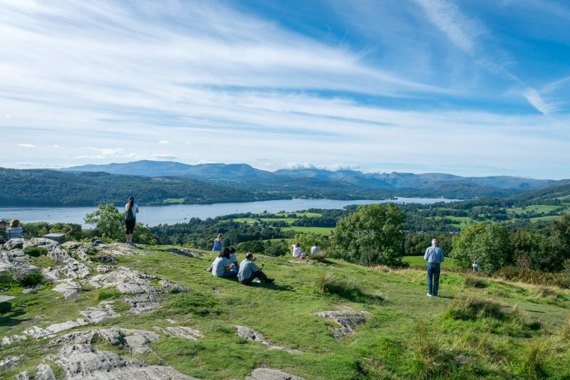 Photo of walkers admiring the view of Windermere from Orrest Head.