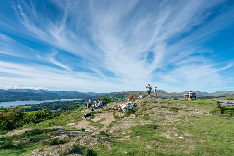 Photograph of walkers on Orrest Head, looking at Windermere.