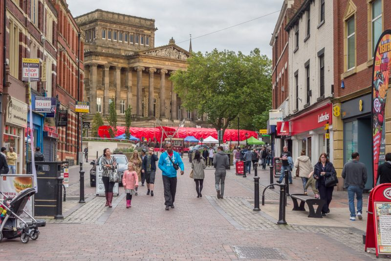 Photograph of Friargate, a shopping street in Preston, Lancashire. The Harris Museum and Art Gallery can be seen in the distance.