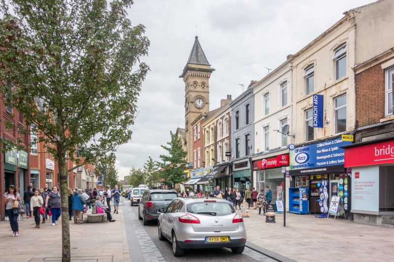 Photo of Fishergate, a busy shopping street in Preston city centre. The Fishergate Shopping Centre is on the left. The tower of the former Fishergate Baptist Church can also be seen.