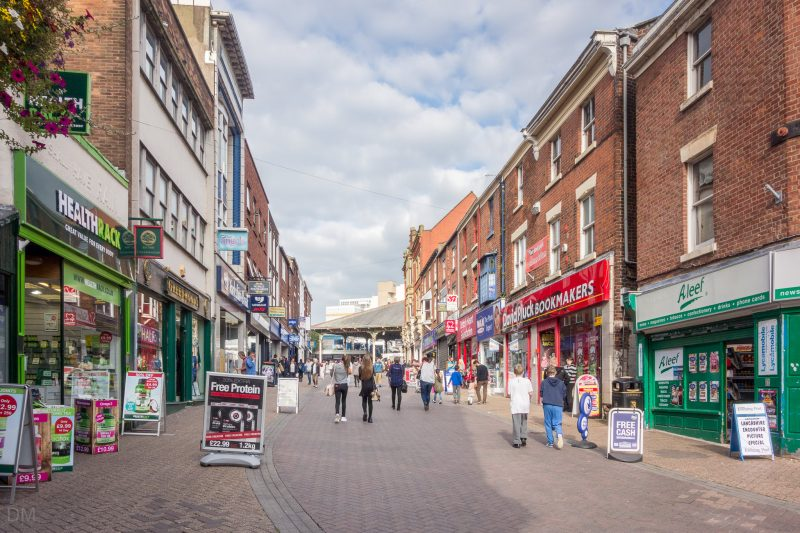 Photograph of Orchard Street, a busy shopping street in Preston city centre.