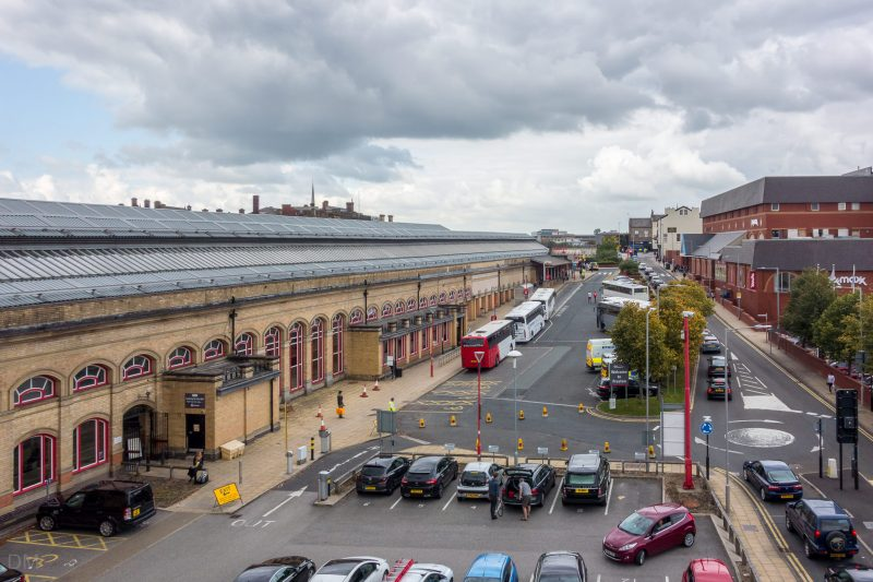 Photograph of Preston Train Station, Preston, Lancashire. The short-stay car park can be seen. The Fishergate Shopping Centre is on the right.
