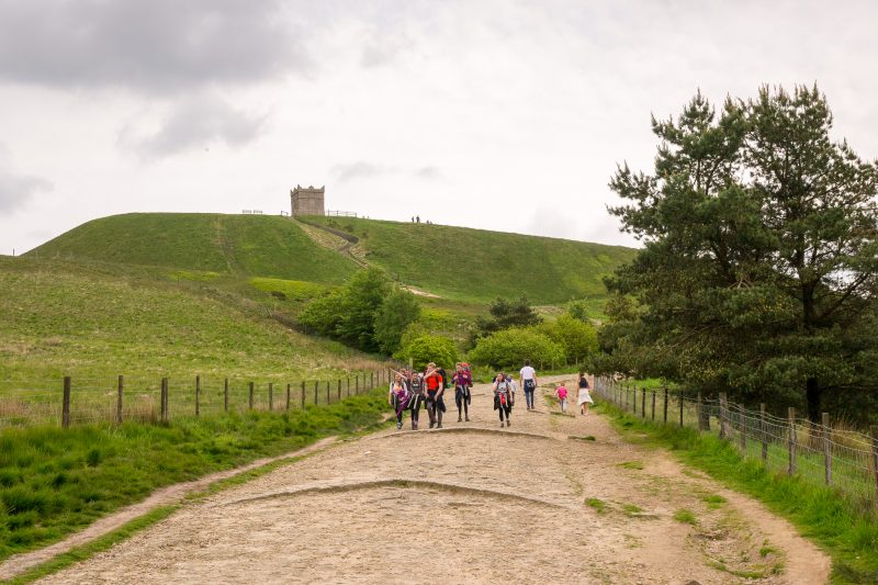 Photo of walkers on the path to Rivington Pike.