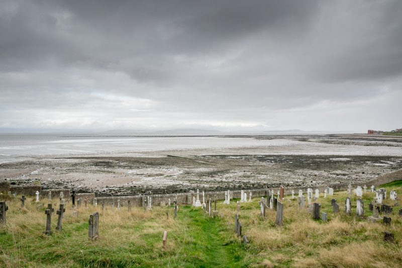 Photograph of Morecambe Bay. Viewed from the graveyard at St Peter's Church, Heysham.