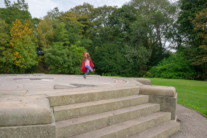 Photograph of a girl playing on the Lancaster Sundial at Williamson Park.