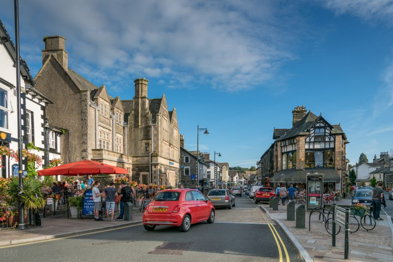 Photograph of Crescent Road in Windermere town centre. The Queens pub and Barclays bank can be seen on the left of the photo.