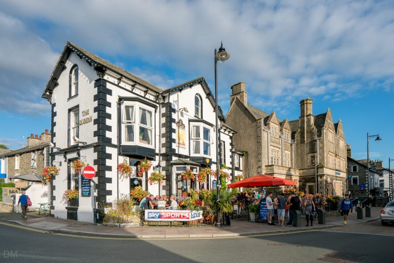Photo of The Queens, a popular pub at the corner of Victoria Street and Crescent Road in Windermere.