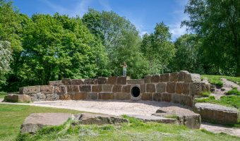Photograph of the children's sandpit and climbing wall at Yarrow Valley Country Park in Chorley.