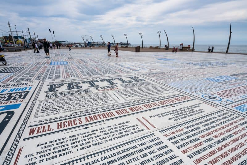 "Photograph of the Comedy Carpet in Blackpool, Lancashire. The slab in the foreground includes the phrase ""Well, here's another nice mess you've gotten me into"", a catchphrase of Laurel and Hardy."