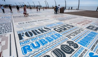 Photo of the Comedy Carpet in Blackpool. The slab in the foreground features scripts from The Two Ronnies show including the Hardware Shop/Four Candles and the Ice Cream Parlour.
