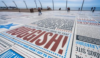 "Photo of the Comedy Carpet in Blackpool. The slab in the foreground features the work of Morecambe and Wise, including the song 'Bring Me Sunshine""."