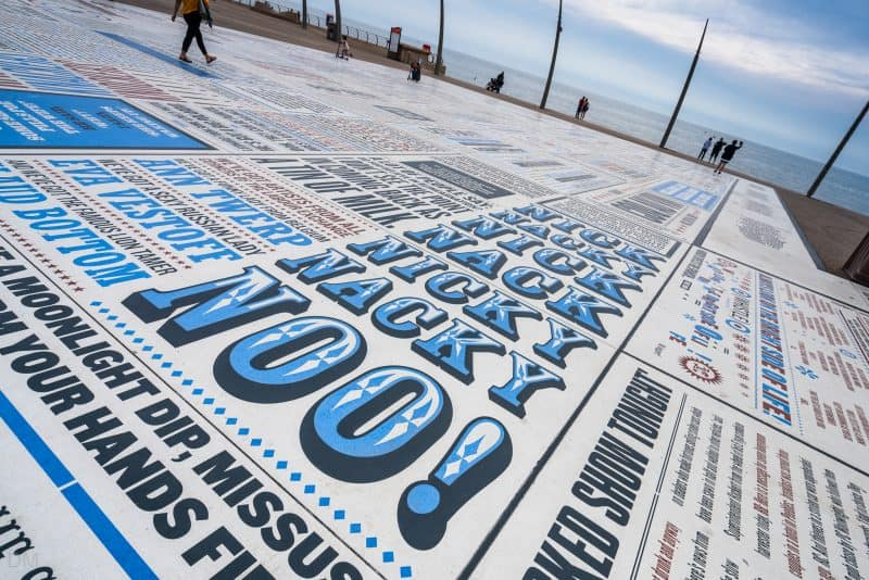 Photograph of the Comedy Carpet in Blackpool. The slab in the photo features the phrases of Ken Dodd.