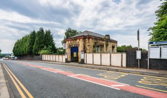 Photograph of the entrance to Moorside Train Station, Salford, Greater Manchester.