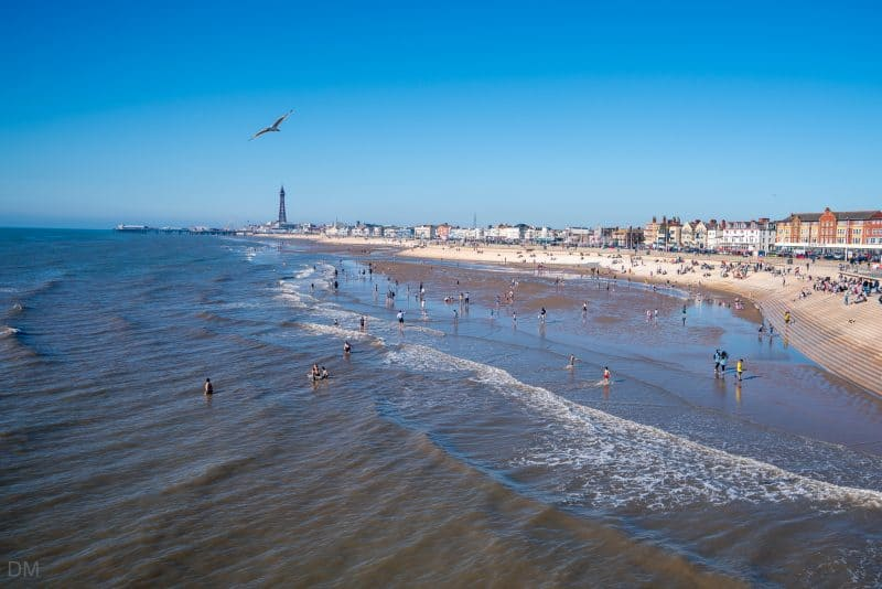 Photograph of Blackpool Tower, Blackpool Beach, and Promenade. Taken from South Pier Blackpool.